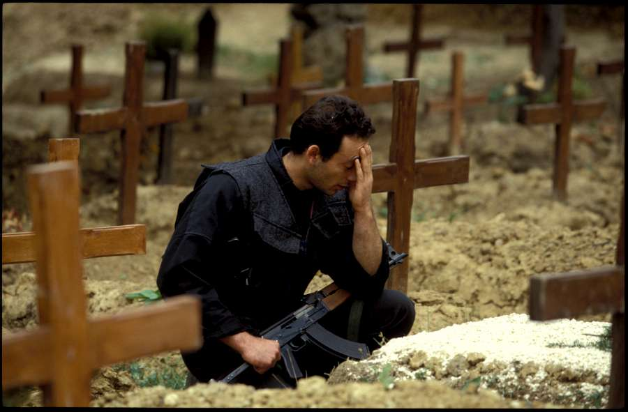 1992: Bosnia. A combattant mourns a fallen comrade during the siege of Sarajevo.