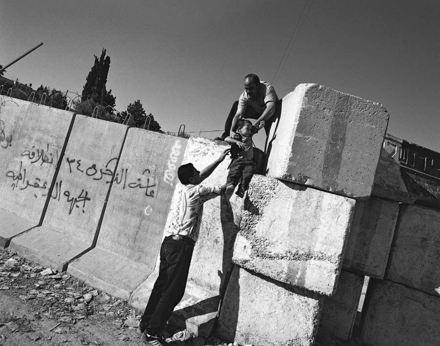 2003: Palestinian residents of Abu Dis crossing the separation barrier in E. Jerusalem.